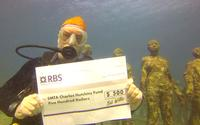 Recent SMTA International Best of Conference Award Winner, Bob Willis pledges half of his award to the Charles Hutchins Educational Grant while on a scuba trip